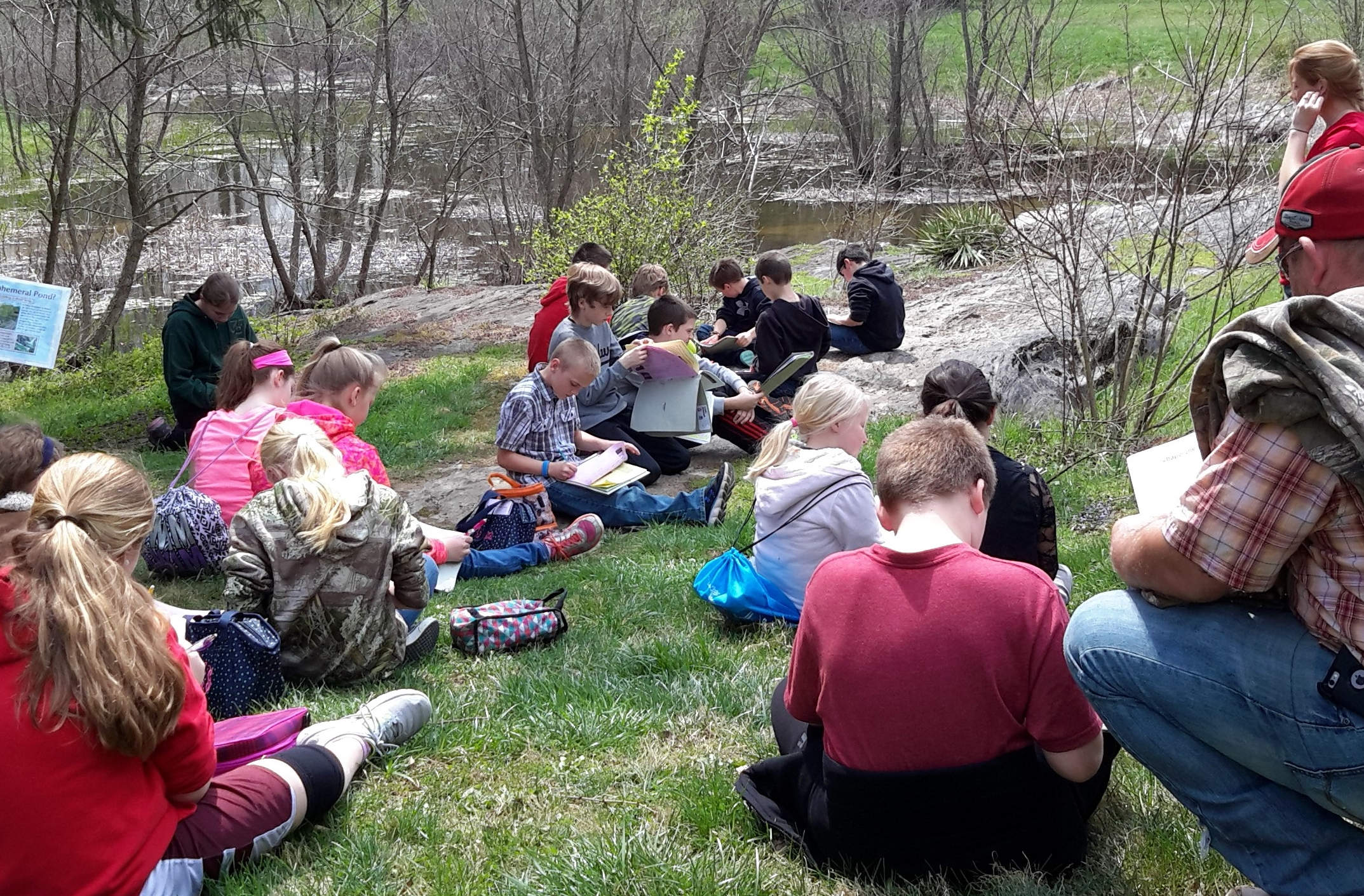 Students study watershed health as they conduct a site analysis at Lake Georgette