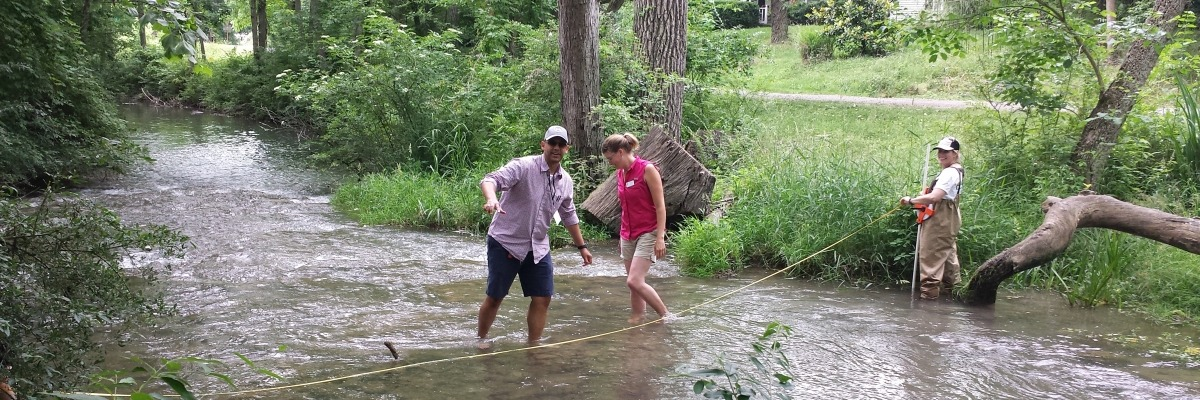 Educators measure the width and depth of a stream in rural Clarke County Virginia.